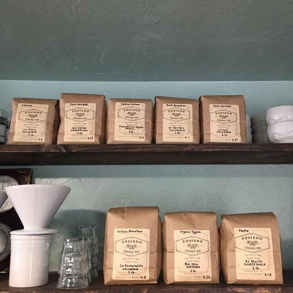 Stock of coffee beans bagged on top shelf