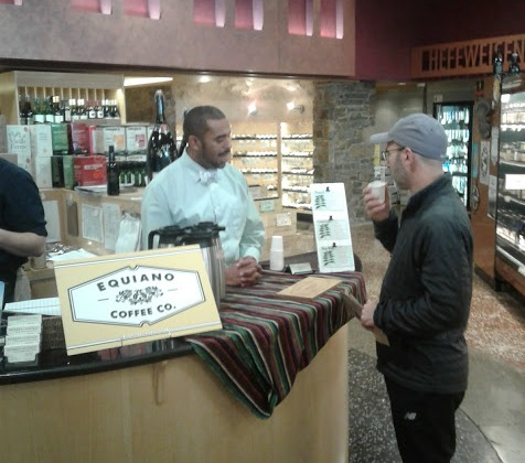 Okon Udosenata, Roastmaster at Equiano Coffee Company samples out coffees for shoppers at Market of Choice in Eugene, Oregon.