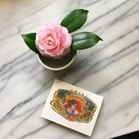 Gift Certificate next to flower